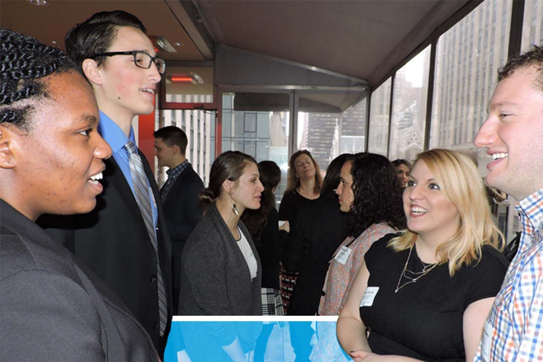 Alumni networking at an event