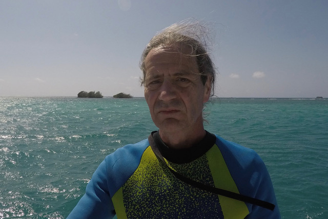 Biology professor Guillermo Orti by the ocean