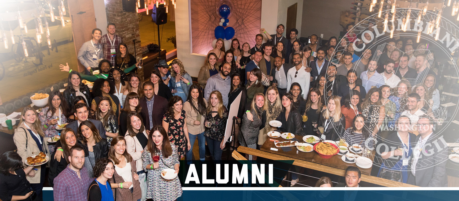 CCAS Alumni Hero: a large group of alumni at a gathering