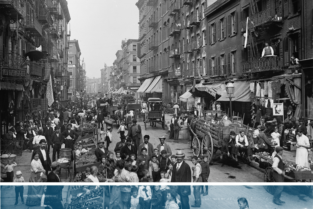 Old black and white photo of people and vehicles on Mulberry Street with a graphic blue line across the bottom.