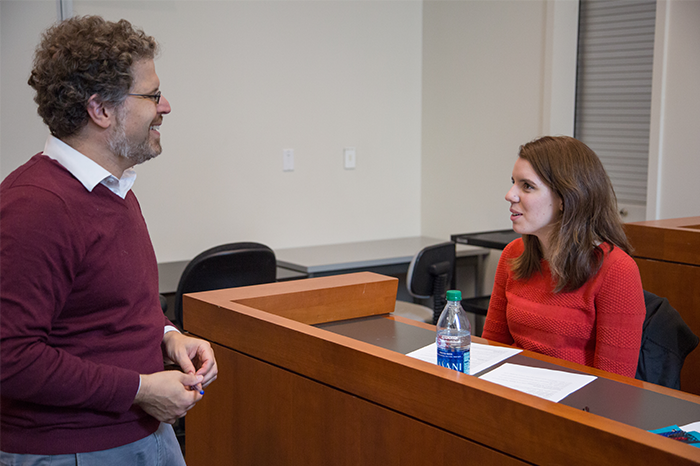 Professor Jamie Cohen-Cole answers a question from student Taylor Stonebarger
