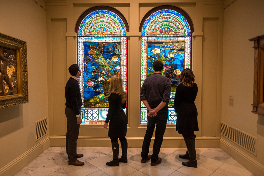 The program's students at the Smithsonian American Art Museum's Luce Foundation Center observing an installation of John La Farge stained glass.