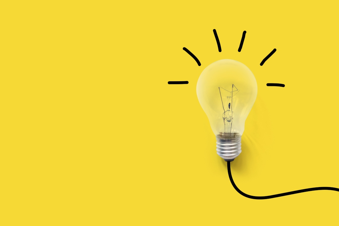 Image of a lightbulb on a yellow background