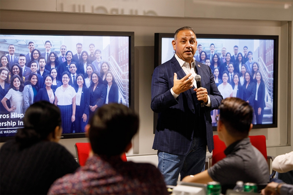 Philanthropist and U.S. Congressman Gil Cisneros, BA '94, speaking at a recent event celebrating the GW Cisneros scholars.