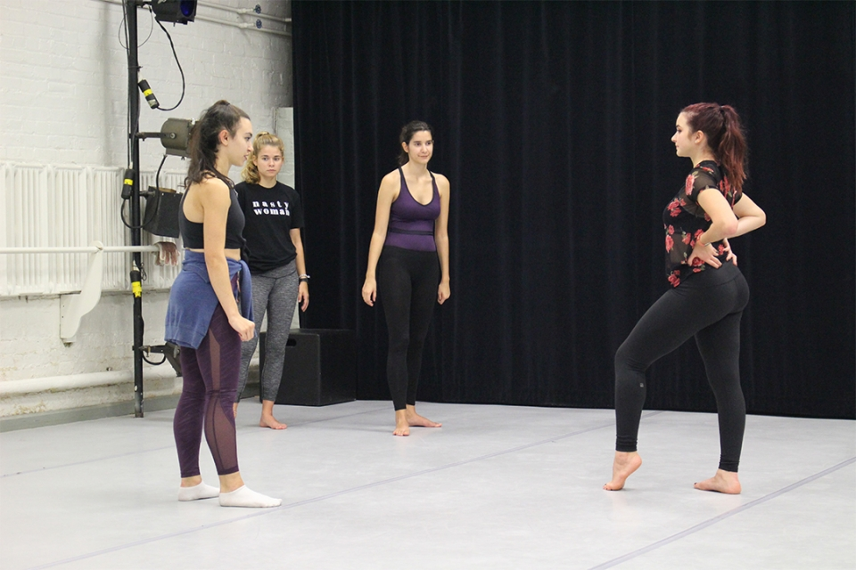 Luther Rice Fellow Eva Gustafson (far left) prepares student dancer Annie Mancuso (far right) for her upcoming production.