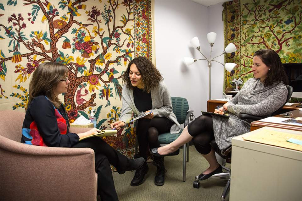 Graduate student Jesse Greenblatt (center) confers with Clinical Fellows Veronica Slaght (left) and Laura Reid (right).