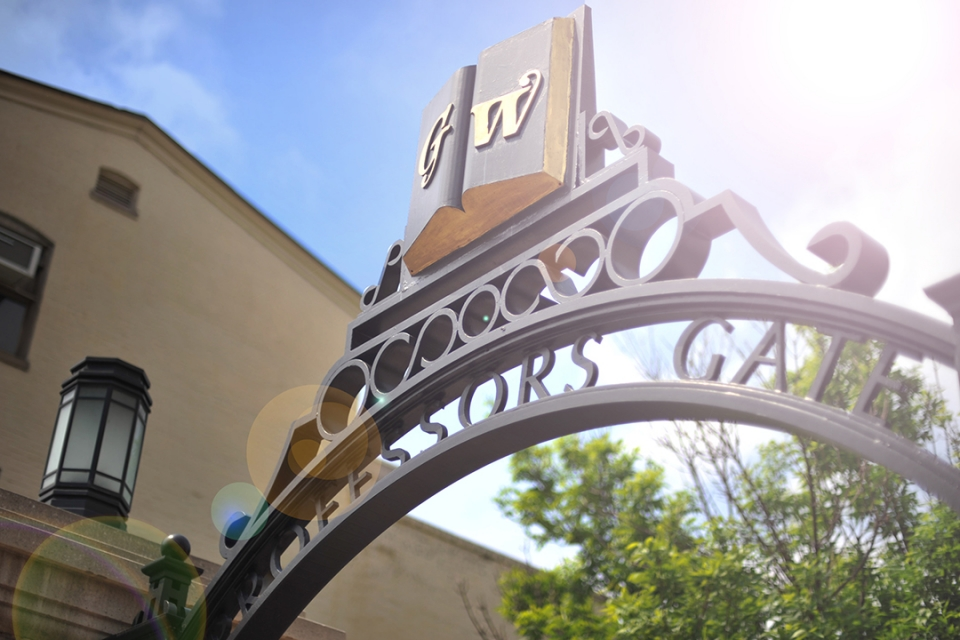 Professor Gate at GW's Kogan Plaza with GW logo on top of the gate