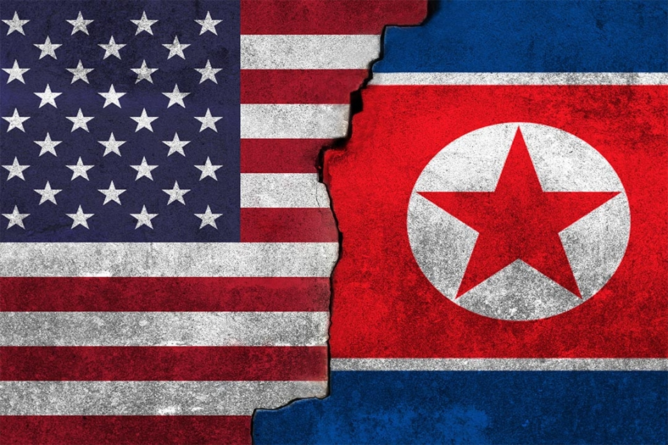 Flag of the United States meshed with flag of North Korea