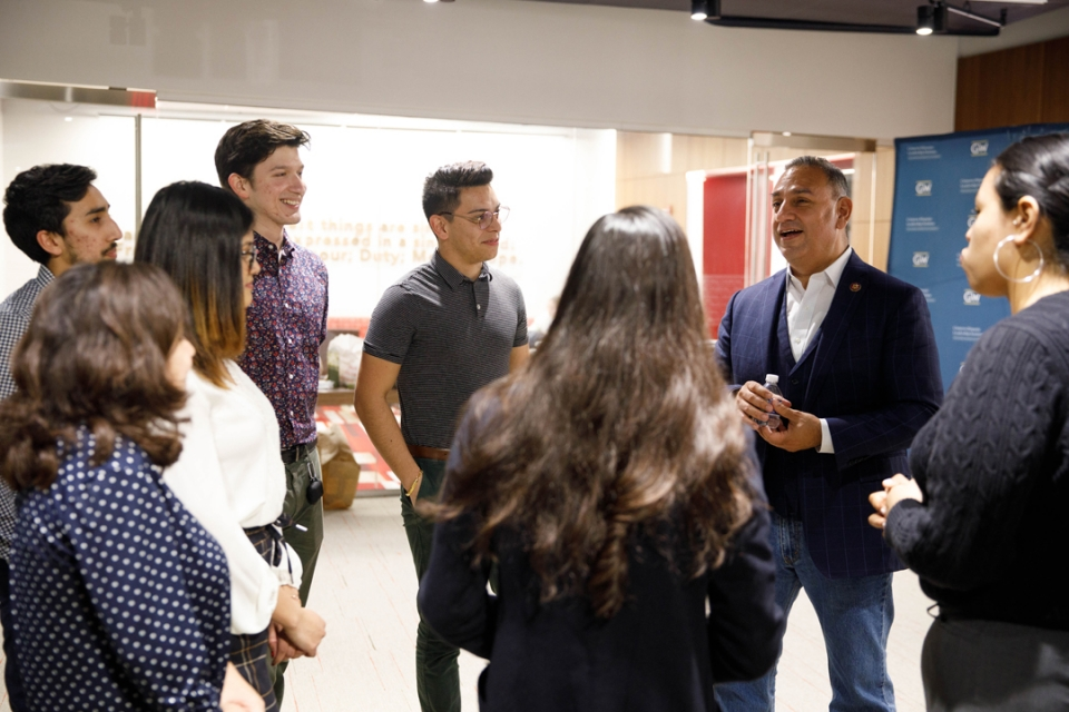 Gil Cisneros speaks to a group of student