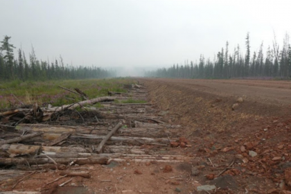 A road in the Irkutsk region of Russia is built on thawing permafrost with logs used to stabilize frozen ground.
