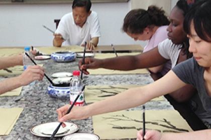 Students practiced traditional Chinese painting techniques at Nanjing