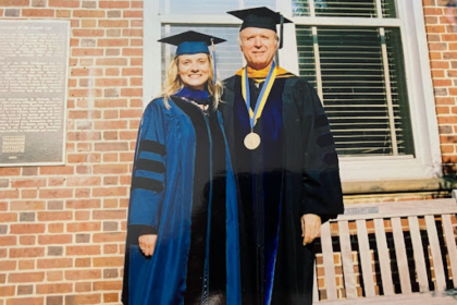 Energy scientist Maggie Teliska, PhD '04, (left) with her faculty mentor Professor of Chemistry David Ramaker, (right) who passe