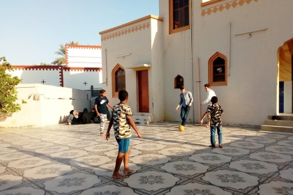 In Muscat, GW students challenged local teenagers to a soccer game.