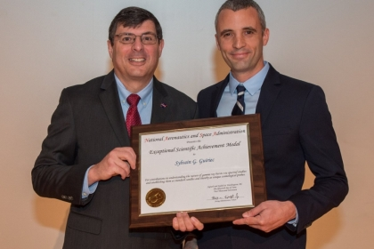 Dr. Guiriec, right, receives NASA's 2017 Exceptional Scientific Achievement Medal