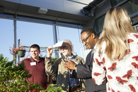Dean Vinson with guests at the greenhouse dedication.
