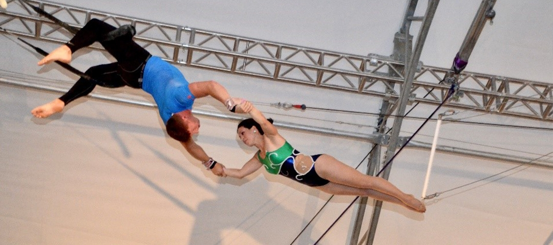 Laura Wooster, BA '97, performing a trapeze act with a male partner